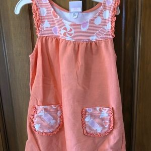 Summer casual orange dress. Worn frequently.